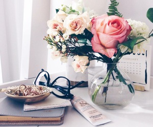 flowers, book, and glasses image