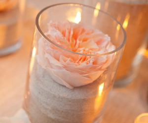 flowers, candle, and sand image