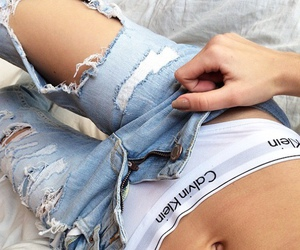 Calvin Klein, ripped jeans, and my calvins image