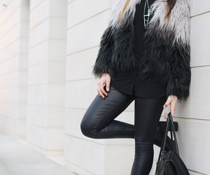 big hair, boots, and glam image