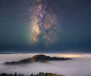 mountains, sky, and galaxy image