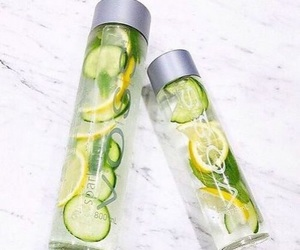 water, lemon, and voss image