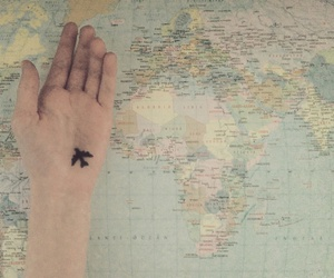 hand, map, and plane image