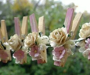 clothesline, clothespins, and flowers as decor image