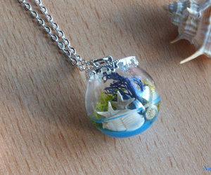 Glass Bottle, Resin, and silver necklace image