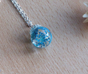 blue flowers, silver necklace, and dried flowers image