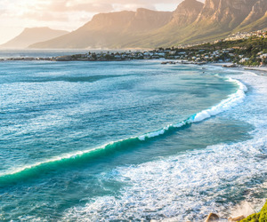beach, mountains, and waves image