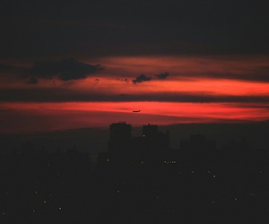 red, sky, and city image