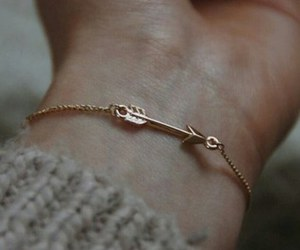 arrow, bracelet, and accessories image