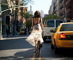 girl, bike, and city image