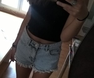 black top, jeans, and short image