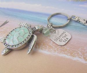 car accessories, turtle keychain, and beach gift image