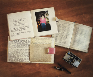 camera, diary, and notebook image