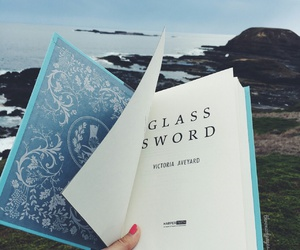 book and glass sword image