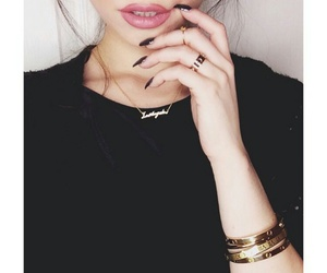 black t-shirt, gold necklaces, and pink lipstick image