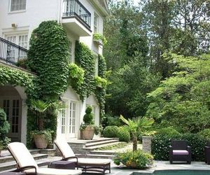 house, pool, and garden image