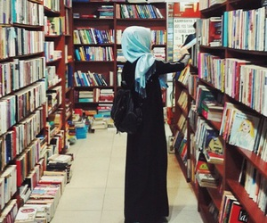 book, hijab, and library image