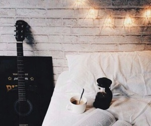 book, guitar, and bed image
