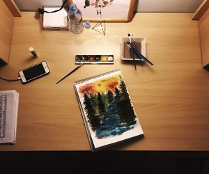Brushes, colors, and desk image
