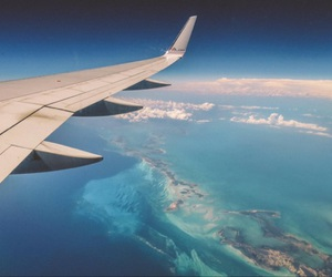 airplane, ocean, and sky image