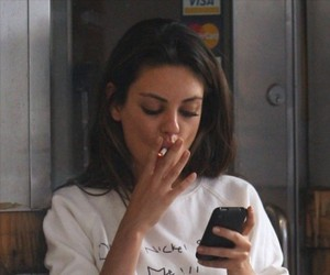 Mila Kunis, cigarette, and smoke image