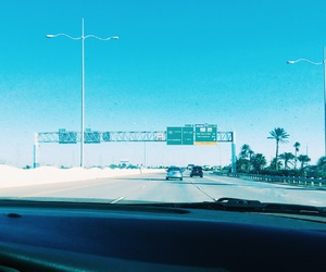 blue, palm trees, and highway image
