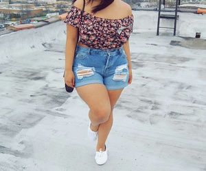 black purse, curvy fashion, and white sneakers image