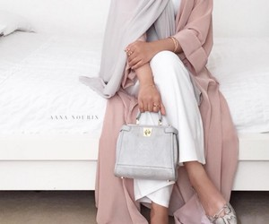 Dubai, hijab, and abaya image