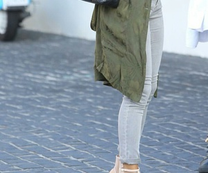 chanel purse, black purse, and grey skinny jeans image