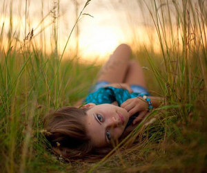 girl, laying, and pretty eyes image