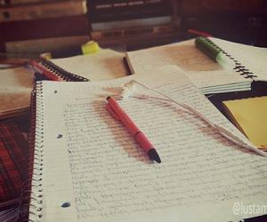 books, earphones, and exam image