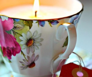 candle, flowers, and teacup image