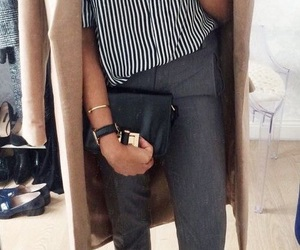loafers, grey pants, and striped top image