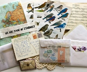 letters, map, and birds image