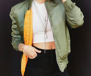 green bomber jacket, white crop tank top, and black high waisted jeans image