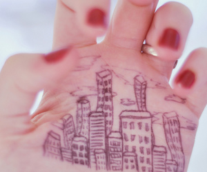 hand, city, and building image