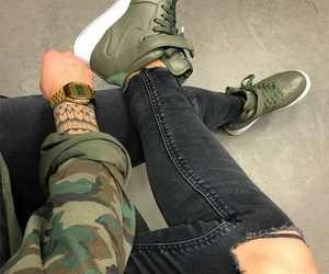 arm tattoos, black ripped jeans, and gold watches image