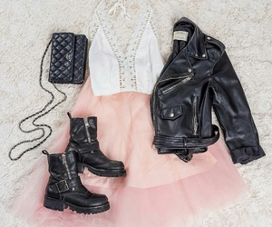black leather jacket, black leather purse, and white lace top image