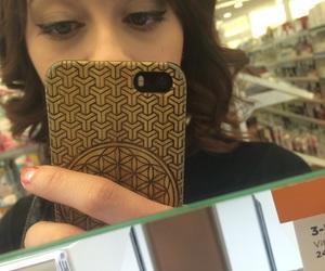 bangs, sacred geometry, and winged eyeliner image