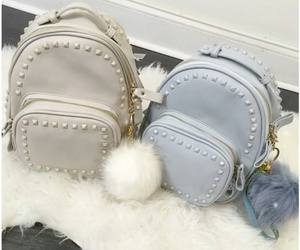 white faux fur rugs, studded backpack, and fur keychain image