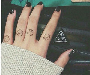 black nails, ivory sweater, and finger tattoos image