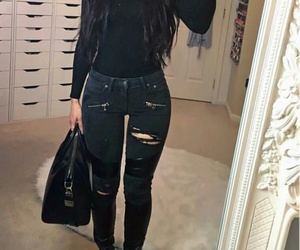 black purse, black ripped jeans, and black sneakers image