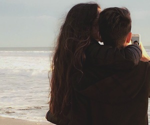 beach, couple, and couple kissing image