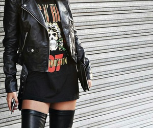 black clutch, black knee high boots, and black leather jacket image