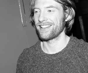 domhnall gleeson, black and white, and smile image
