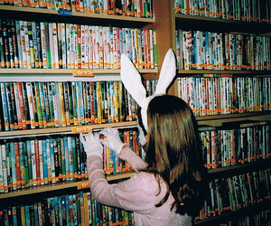 girl, book, and dvd image