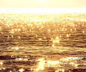 sea, gold, and ocean image