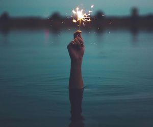 fireworks, water, and hand image