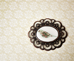 cameo, frame, and earrings image