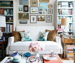 books, flowers, and sofa image